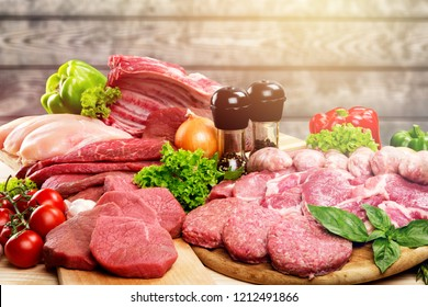 Fresh Raw Meat Background with vegetables, meat concept, butcher's shop.