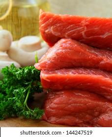 fresh raw meat on a kitchen cutting board