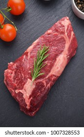 Fresh raw meat with rosemary