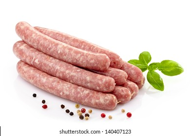 fresh raw meat sausages on white background
