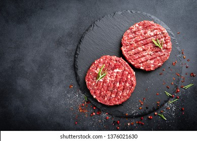 Fresh raw minced beef steak burgers with spices