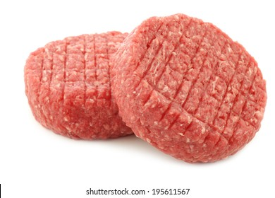 fresh raw minced meat for making hamburgers on a white background