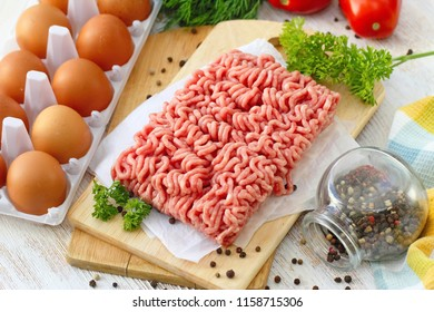 Fresh raw minced meat with spices ready to be cooked