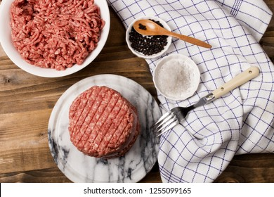 fresh raw northern ireland beef burger patty with reduced fat on marble