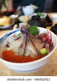 Fresh raw octopus with cod fish in bowl . Japanese food. Raw food.raw squid food