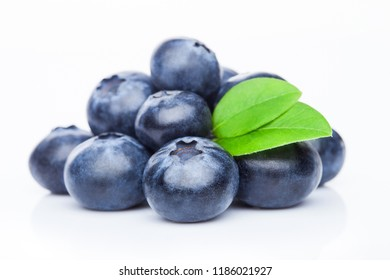 Fresh raw organic blueberries with leaf on white background.