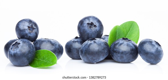 Fresh raw organic blueberries in vintage wooden box on kitchen background.
