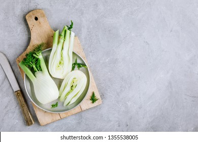 Fresh raw organic florence fennel bulbs or fennel bulb on gray stone background. Top view