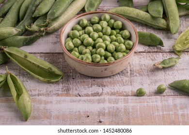 fresh and raw peas on table