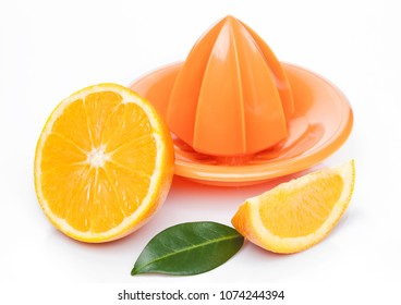 Fresh raw peeled oranges with juice squeezer with leaves on white background