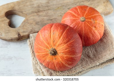 Fresh raw red kuri squash in autumn season