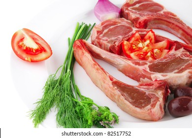 fresh raw red ribs on white plate