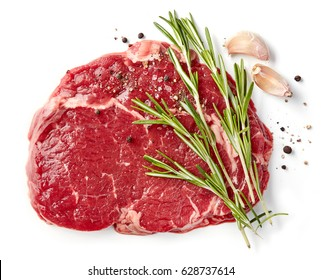 fresh raw rib eye steak isolated on white background, top view