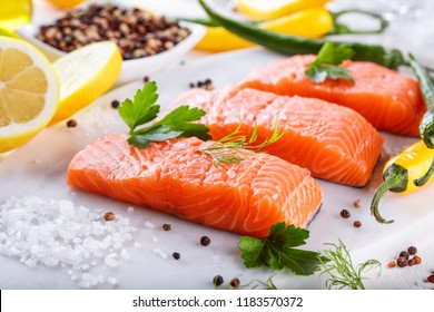 fresh raw salmon fillet with aromatic herbs  spices