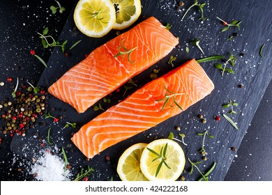 fresh raw salmon fillet with aromatic herbs, spices
