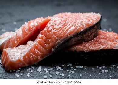 Fresh raw salmon on a black rock