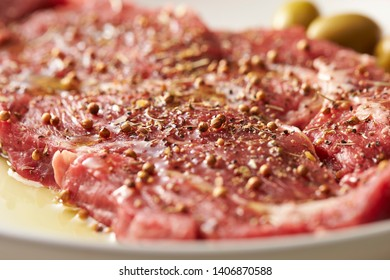Fresh raw seasoned beef with olive oil