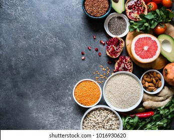 Fresh raw seeds, cereals, beans, superfoods, herbs  for healthy cooking. top view. copy space. Diet or vegetarian food concept