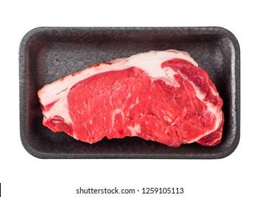 Fresh raw sirloin beef steak in plastic tray on white