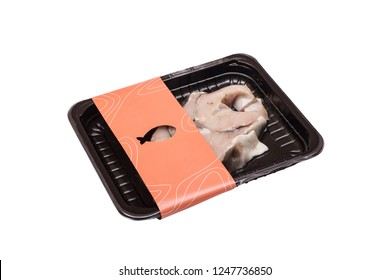 fresh raw sturgeon steak fish in vacuum package. isolated on white background.