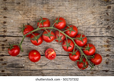 Fresh raw tomatoes on a wooden background