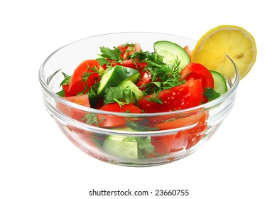 fresh raw vegetable salad in bowl over white