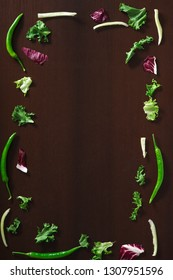 Fresh Raw Vegetables In Chunks on wooden table in different shape