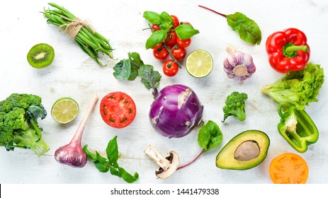 Fresh raw vegetables on a white background Wooden. Top view. Free space for your text.