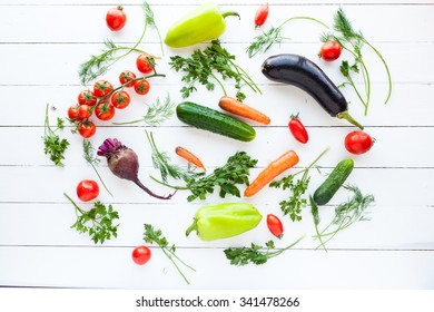 Fresh raw vegetables on white wood table, concept