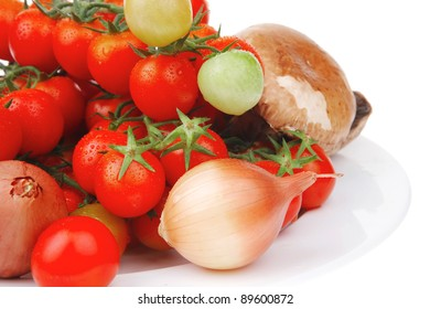 fresh raw vegetables ready for salad on white