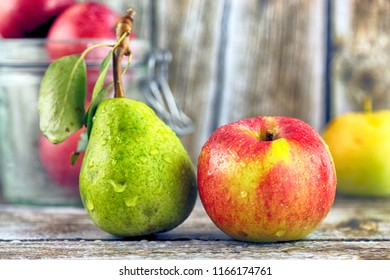 Fresh, real apple and pear from organic farming, ecological harvest on wood background.