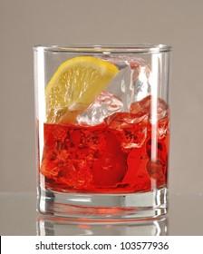 Fresh red appetizer drinks and lemon.