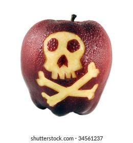 Fresh red apple carved with skull & crossbones symbol