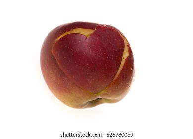 Fresh red apple with a heart shaped cut-out on a white background