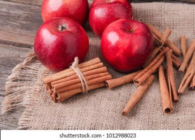 Fresh red  apples with cinnamon sticks