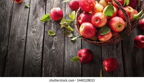 Fresh Red Apples With Green Leaves On A Wooden  Background. Top view