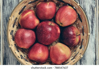 Fresh red apples. Natural apples in a wicker basket.
