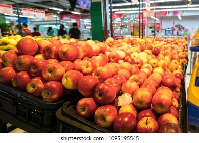 Fresh red apples on shelf in supermarket.