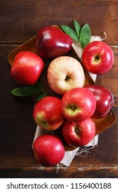 fresh red apples on wooden background, top view