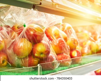 Fresh Red apples in plastic bag ready for sale in supermarket