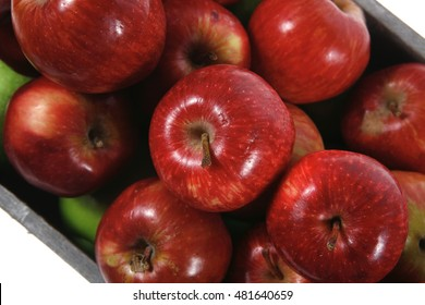 fresh red apples in vintage grey box ready to sell isolated on white background