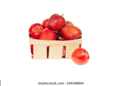 Fresh red apples in wooden basket isolated, autumn harvest