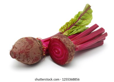 Fresh red beet roots and half with leaves isolated on white background