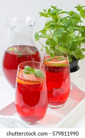 Fresh red berry drink in glass. White background. Copy space.