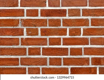 Fresh red brick wall  built of new ancient style  bricks.