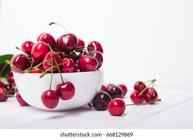 fresh red cherry fruit in plate on wood table