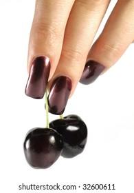 fresh red cherry in human hand
