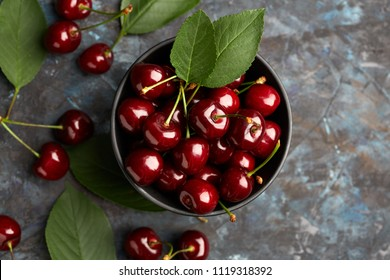 Fresh red cherry on a dark background. Cherries. Healthy food concept.