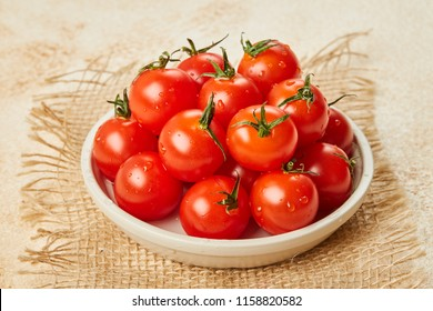Fresh Red Cherry tomatoes in bowl on wooden background