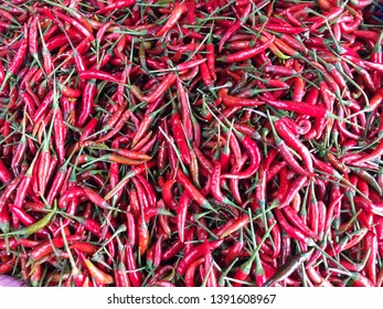 fresh red chili close up in group